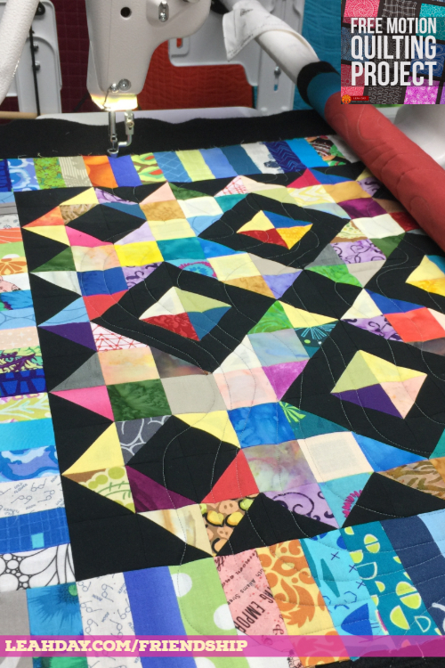 longarm quilting a scrap block on a frame